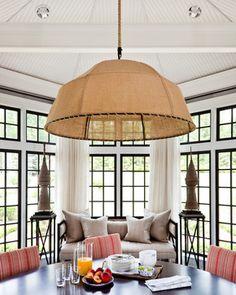 perfect idea for breakfast nook - black windows/white sheer floor length curtains between each set of windows.