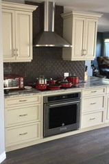 A current trend in kitchens is the chimney range hood as featured in this kitchen. Kitchen Reno, Kitchen Cabinets, Chimney Range Hood, Stone Countertops, Plumbing, Kitchens, Flooring, Home Decor, Kitchen Cupboards