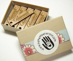 These would be a cute detail for packaging!  Custom Wooden Hang Tags With Your Shop Name or Logo (2x.5in). $25.00, via Etsy.