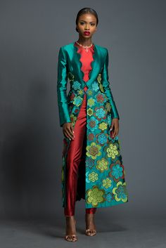 AMAL X NIKOLINA Tropical rain forest green pelisse adorned with Komole Kandids Daisy motif. Dark candy apple red Nikolina fitted trousers and crop top.