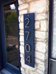 Contemporary house numbers on painted background.