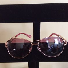 Rocawear sunglasses Awesome Roca Wear rose color tinted sunglasses. Gold tone frame and beautiful gold tone and rose open design on sides. Perfect blend of cool and feminine! Rocawear Accessories Sunglasses