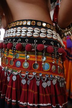Gypsy cowrie & mirror embellished belt for a boho chic allure. FOLLOW this board >>> http://www.pinterest.com/happygolicky/the-best-boho-chic-fashion-bohemian-jewelry-gypsy-/ for the BEST Bohemian fashion trends for 2015 now.