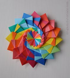 This is my take on the origami Star Festival star by Nabuko Okabe. This is a modular design that takes 16 units to create this colorful, decorative origami star. Origami Paper Folding, Origami And Kirigami, Origami Fish, Modular Origami, Origami Ball, Origami Wreath, Oragami, Rainbow Origami, Origami Star Box