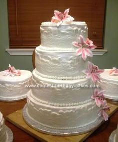 Homemade Wedding Cake: I made this wedding cake for my neighbor who is also a good friend. It was a four tier stacked cake with four satellite cakes. The cake was white  with
