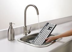 Logitech Washable Keyboard — Gadgets -- Better Living Through Design - You wouldn't believe how filthy and germy keyboards really are. Gadgets And Gizmos, Tech Gadgets, Cool Gadgets, Office Gadgets, Unique Gadgets, House Gadgets, Latest Gadgets, Kitchen Gadgets, Der Computer