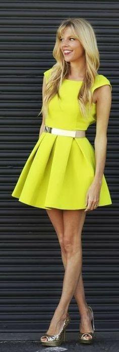 Attractive yellow neon mini dress with golden waist belt