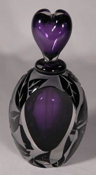 Purple and black perfume bottle