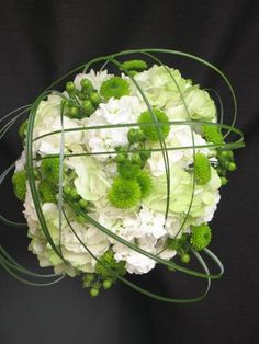 Love the bear grass creating a cage around the bouquet, it creates a lot of interest