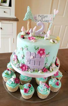 A fairytale garden themed birthday cake for a Birthday from Kim's cake gallery in leamington spa, Warwickshire 2nd Birthday Cake Girl, Garden Birthday Cake, Garden Party Cakes, Bithday Cake, Themed Birthday Cakes, Woodland Fairy Cake, Fairytale Birthday Party, Fairy Cakes, Fairy Garden Cake