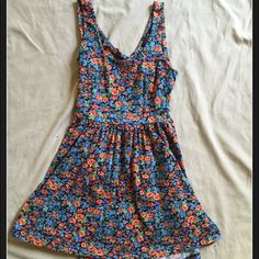 Floral sundress Fun & flowy sun dress which is finger tip length. An open, triangle cut out back Dresses Mini