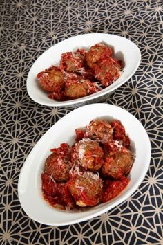 EGGPLANT MEATBALLS 1 lg eggplant 3 cloves garlic 2 T olive oil 28 oz can diced tomatoes, with their juices 1 t salt 3 lg fresh basil leaves, torn, + 1 T minced fresh basil 3 cups fresh bread crumbs 2 lg eggs, lightly beaten 2 oz pecorino Romano cheese, freshly grated 1 T minced fresh flat-leaf parsley 1 cup flour, for coating, or more as needed Vegetable oil, for frying cheese, for serving