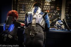 """""""Meet me at the bar...""""  Myself cosplaying as N7 armour female Commander Shepard, and L2 Biotic Cosplay (https://www.facebook.com/L2Bioticcosplay?fref=ts) cosplaying as Kaidan Alenko from the Mass Effect video game trilogy. Photo taken by Giles Warhurst of Silver Lining Studios (https://www.facebook.com/pages/Silver-Lining-Studios/1564999847103681?fref=photo)"""