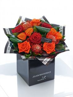 Autumn is a season of glorious colour — from russet and burnt orange to rich scarlet and red — and this hand-tied bouquet reflects the most vibrant colours in sophisticated style. Orange Wedding Flowers, Romantic Flowers, Bridal Flowers, Fall Flowers, Orange Flowers, Cork, Online Flower Shop, Autumn Rose, Hand Tied Bouquet
