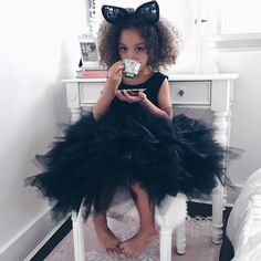 Pretty cute kiddo with cat ear headband and black tutu