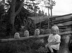 with baby owls (c.1925)