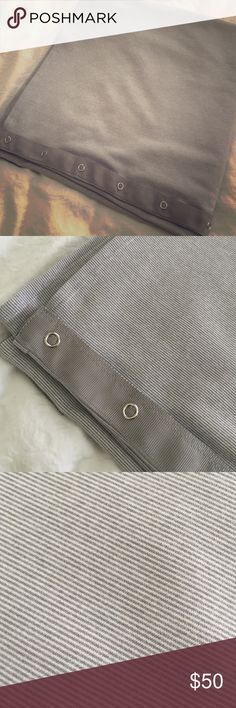 Versatile grey/white lululemon Vinyasa scarf Versatile, wardrobe staple. Lululemon Vinyasa scarf. Mini-grey stripe on one side with grey grosgrain ribbon & snaps. White on reverse side with grey stripe trim. Excellent condition. Worn 1-2x. lululemon athletica Accessories Scarves & Wraps