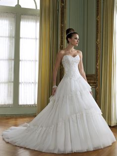 I absolutely love the layers down the skirt of the gown.- THIS IS BREATHTAKING!