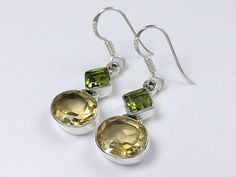 Sterling silver citrine peridot earrings. Unique design sterling silver earrings with mix of sunny warm citrine and peridot cut stones and fine details throughout.