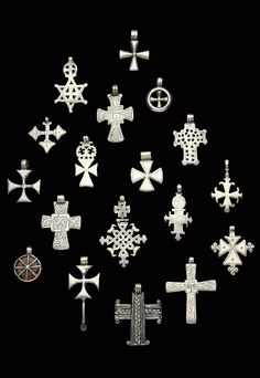 Ethiopia | Collection of silver pendant crosses; mostly dating from the 19th century || Ghysels Collection, photograph John Bigelow Taylor