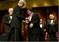 Nobuyuki Tsujii receiving his gold medal from legendary American pianist, the late Van Cliburn in the 2009 Van Cliburn Piano Competition