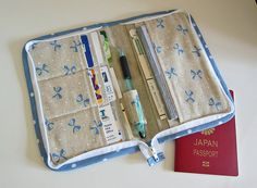 Zip Organizer -- card slots, passport & check book pocket, outside zipper pouch, pen holder....All around zip closure.
