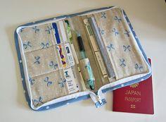 Zip Organizer -- card slots, passport & check book pocket, outside zipper pouch, pen holder....All around zip closure.