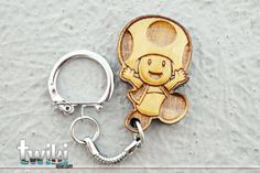 Laser cut and engraved Mario bros Toad wood keyring. By TwikiConcept on Etsy