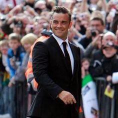Robbie Williams, love that grin!