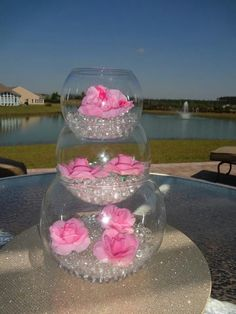 Pretty!!! White water beads with pink flowers, stacked 3 fishbowl high.