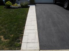Non-colored stamped concrete added to the side of an asphalt driveway in Ohio. Blacktop Driveway, Asphalt Driveway, Stone Driveway, Driveway Pavers, Stamped Concrete Driveway, Concrete Driveways, Driveway Lighting, Driveway Entrance, Paver Sidewalk