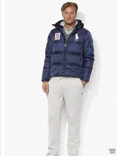 A hearty down jacket is given an athletic update with a detachable hood and sporty patch at the chest at overitock.com