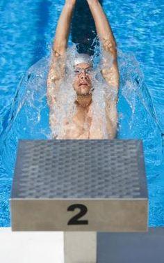 Short Swim Workouts | LIVESTRONG.COM 30-minute swim workouts, ladders, let intensive, etc.