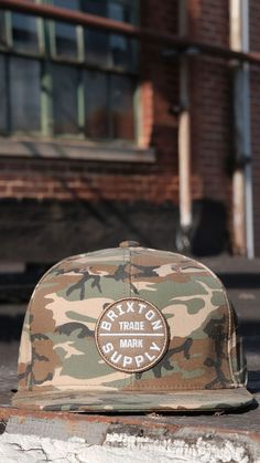 The Oath III Snapback by Brixton ia a 6-panel cut-and-sew cap featuring an embroidered patch and with a rigid structured crown. It has a plastic snap closure. Camo Hats, Sports Caps, Embroidered Patch, Snap Backs, Brixton, Brand You, Branding Design, Patches, Plastic