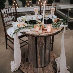 This table has me like -  #Repost @stateandarrow  Pretty little sweetheart table for A&A. They were really passionate about choosing local vendors and supporting local artists for their big day from a custom @ghindacouturebridal dress to the silk gauze table runners from @thelesserbear. We also had a ton of fun re-purposing old items from around the greenhouse like this old spindle. Every little detail just felt special! : @racheljoybarehl #lexnlane