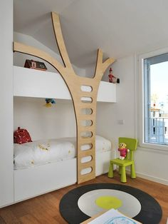 Built-in bunk beds, children's room, wooden tree design.