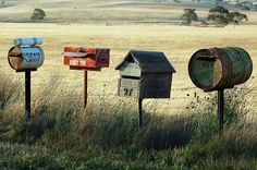 mailboxes out of drums, old tool box..very cool