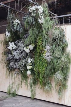 Beautiful flower wall for a wedding in green, pale blue and white