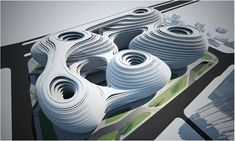 """Recently completed in 2012 by Zaha Hadid Architects, the Galaxy Soho in Beijing, China, is a courtyard, which consists of office space and a retail entertainment complex; it spans to about 332,00 square meters (about 3570 feet)—omitting any hard edges, and rather the structure integrates, """"five continuous flowing volumes of the building,"""" as described by the firm. Source NewsGallery"""
