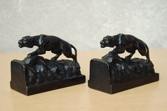 At mid-century, these impressive black panther bookends were already on their…
