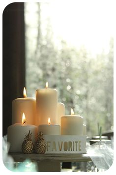 simple centerpiece of ikea candles and silhouette cut words