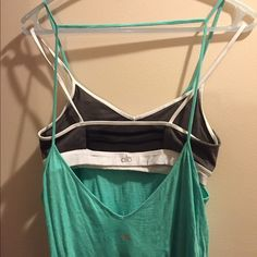 ALO Yoga low back real tank Really cute workout tank from ALO Yoga. It's the best for showing off a cute bra. (The one pictured is NOT included). ALO Yoga Tops