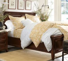 I like that it has a footboard, yet you can still hang a duvet over the end.    (Hudson Bed - Pottery Barn)