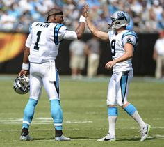Carolina Panthers quarterback Cam Newton (1) congratulates kicker Graham Gano (9) on a field goal in the first half against the Minnesota Vikings at Bank of America Stadium on Sunday, September 25, 2016. The Vikings won, 22-10.