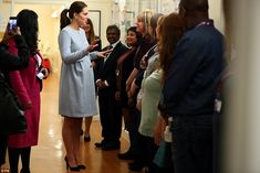 After meeting mothers and babies, the Duchess joined a meeting with experts including health visitors, midwives and community nurses. Briefed on research that found that, in the boroughs local to the London hospital, one in four perinatal women experience some form of mental health issues, the Duchess said: 'There's an expectation you're going to be super happy all the time, and one in four of us aren't'