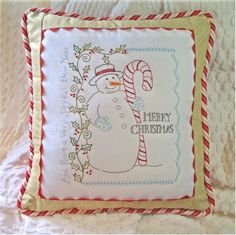 "Vintage Candy Cane Snowman: This darling snowman was created by Meg Hawkey of Crabapple Hill designs. The finished pillow measures 14"" x 16""."