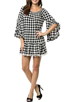 This adorable ruffle sleeve houndstooth tunic will be the perfect addition to your wardrobe and a must have for game day apparel. The stretch neck can be worn on or off of the shoulders. It has white ball fringe accenting the bottom and will be cute paired with your favorite jeans or leggings. True to size, made in the USA.   Houndstooth Tunic  by KITTY COUTURE . Clothing - Dresses - Casual Alabama