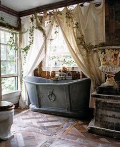 Bohemian Chic Tub -- I love this, still would love to have a clawfoot tub. Maybe this is the guest bathroom??