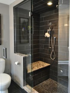 river rock floor, shower with a seat, glass walls, love.