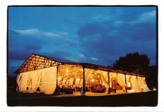 barn farm wedding with curtains and string lights. Could switch it up to a white no side tent rental with sheer curtains on the sides
